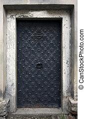 Big metallic old door. Historical house door, one timber...
