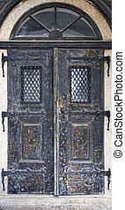 Wooden old door. Historical house door. Rural entry...