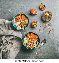 Healthy vegetarian breakfast over grey concrete background,...