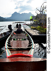 Thai people sail long tail boat serviced for sending and...