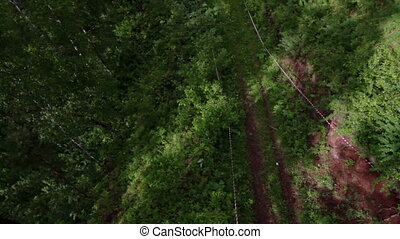 POV Cableway view Chairlift in forest - Point of view...