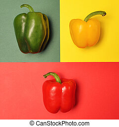 Three colorful paprikas on multicolored backgrounds -...