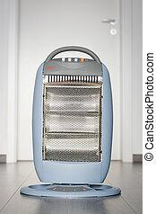 Halogen or infra heater in action against wooden floor