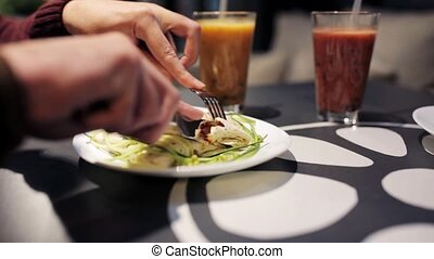 people eating or having dinner at vegan restaurant - healthy...