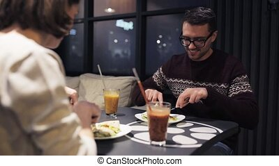 happy couple having dinner at vegan restaurant - eating,...