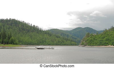 River tourist speed boat mountain landscape - Boat view of...