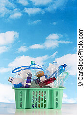 Recycling plastic basket filled with containers isolated