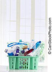 Recycling plastic basket filled with  containers isolated on white