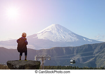 Boy's backpack and Mount Fuji in Japan. - Boy's backpack...