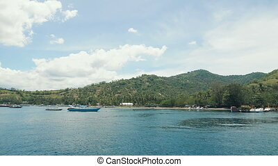 Several small boats moored close to the beautiful tropical...