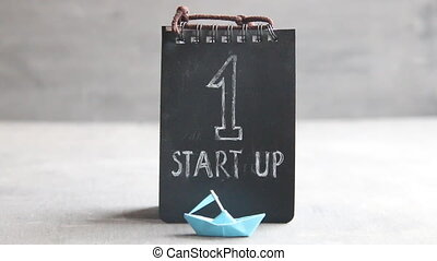 Startup Business text and paper boat - Startup Business,...