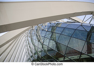 Glass ceiling footbridge with metal structures