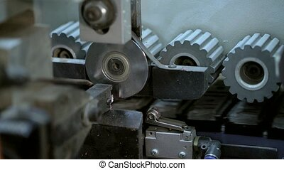 Woodworking machinery at factory close up shot - Gear metal...