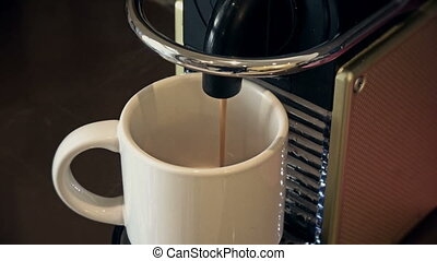 Coffee filling a cup - Coffee machine filling a white cup