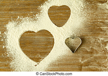 Heart shape in the sifted flour on the table