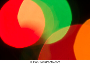 green and red color bokeh on black  abstract background.