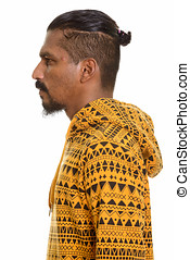 Profile view of young Indian man