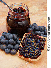 jam - sweet blueberries jam on toast close up