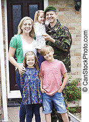 Portrait Of Family With Army Father Home On Leave