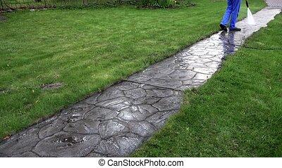 Man Wash Concrete Path With Pressure Washer. Garden...
