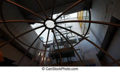 View trough the roof of SkyView incline elevator to the wall...