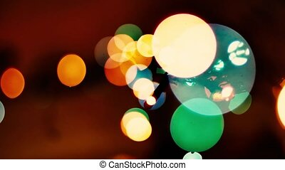 Colorful octagons blink on dark background. Multicolored defocused lights blinking.
