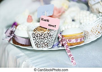 Pretty white cupcakes in laces lie on a plate
