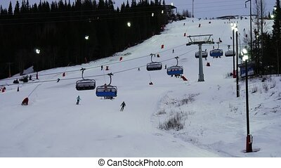 Chair lift over the slope at a ski resort in Sweden