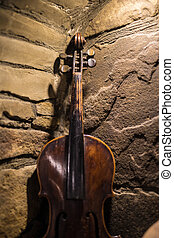 Old wooden violin - Violin in vintage style on stone...