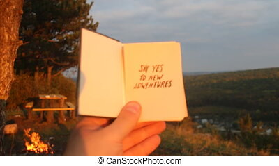 Say yes to new adventures. - Book with the inscription Say...