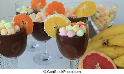 Chocolate pudding with whipped cream and fruits
