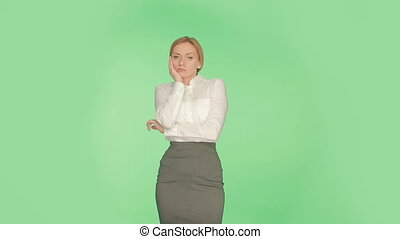 Propped cheek on his hand. girl green background. language...