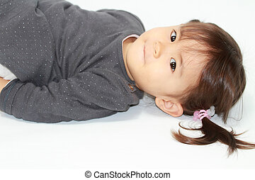 Lying Japanese girl (2 years old)
