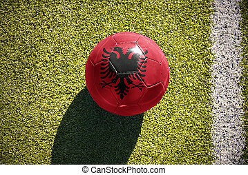 football ball with the national flag of albania lies on the...