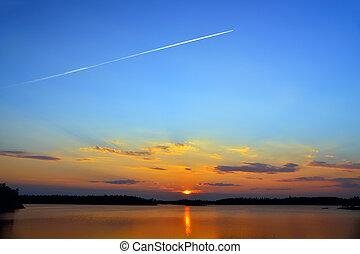 Plane flies to the West. Lake Engozero, North Karelia,...