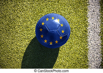football ball with the national flag of european union lies...