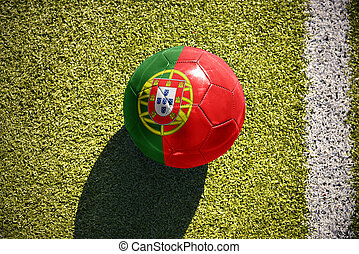 football ball with the national flag of portugal lies on the...