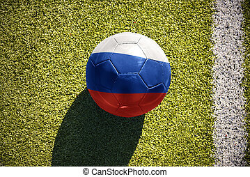 football ball with the national flag of russia lies on the...