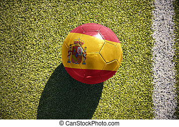 football ball with the national flag of spain lies on the...