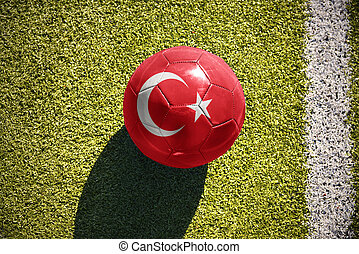 football ball with the national flag of turkey lies on the...
