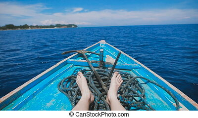 Ocean island of Bali. Boat tour. Young man in a boat on the...