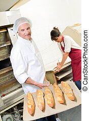 baker with baguettes