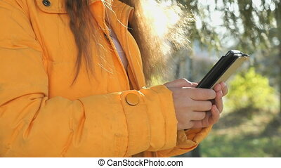 The attractive girl holding a mobile phone