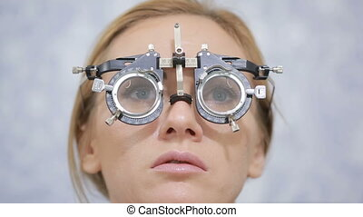 woman at the reception of an ophthalmologist. the selection...