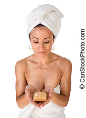 Ethnic Woman preparing for sauna hold bar of soap
