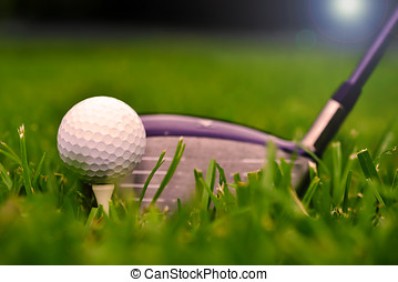 Macro shot of a golf club with ball and tee on the fairway...