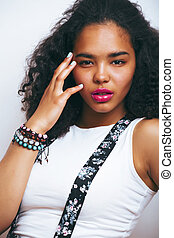 young pretty african-american teenage woman posing in...