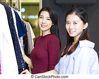 young asian women in clothing store - beautiful young asian...