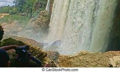 Foamy Wall of Wide Powerful Waterfall among Rocks - foamy...