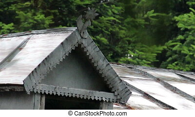 old attic - close-up old decorative attic at the roof